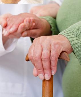 caregiver holding senior hand