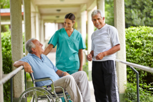 two elderly man talking to a caregiver